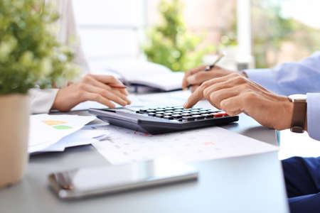 Photo pour Tax accountants working with documents at table - image libre de droit