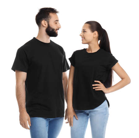 Foto de Young couple in t-shirts on white background. Mockup for design - Imagen libre de derechos