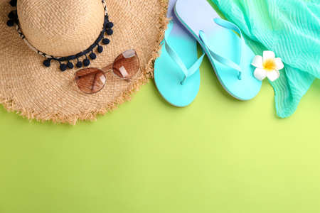 Photo for Flat lay composition with stylish hat and beach objects on color background - Royalty Free Image