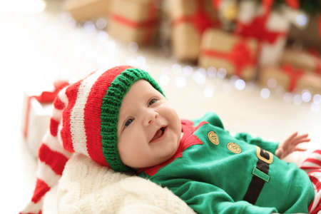 Photo for Cute baby in Christmas costume at home - Royalty Free Image