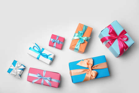 Photo for Flat lay composition with beautiful gift boxes on white background - Royalty Free Image