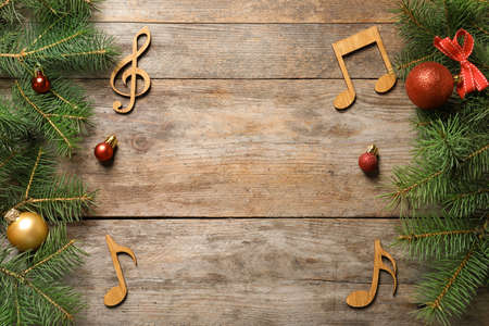 Photo for Flat lay composition with decorations and  notes on wooden background. Christmas music concept - Royalty Free Image