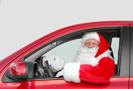 Photo pour Authentic Santa Claus driving red car, view from outside - image libre de droit