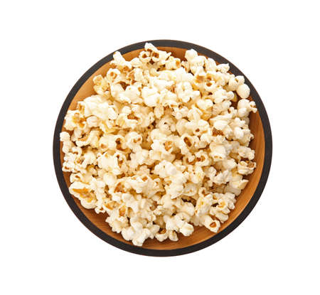 Foto de Bowl of tasty popcorn on white background, top view - Imagen libre de derechos