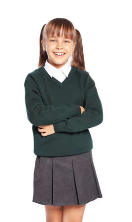 Photo for Little girl in stylish school uniform on white background - Royalty Free Image