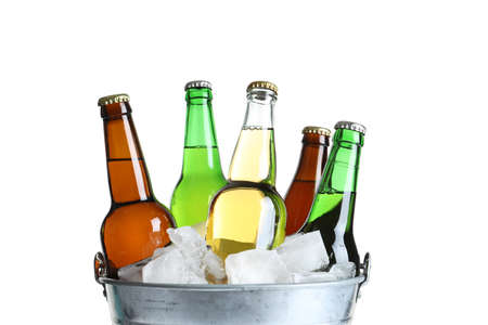 Photo for Bottles with different types of beer and ice in metal bucket on white background - Royalty Free Image