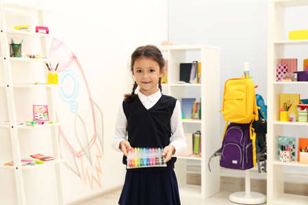 Photo pour Cute child choosing school stationery in store - image libre de droit