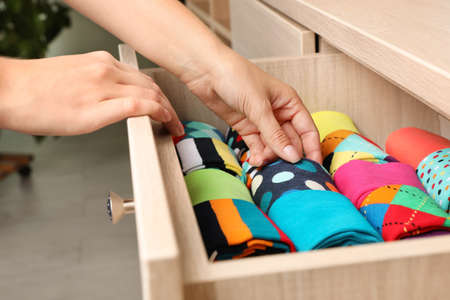 Photo for Woman opening drawer with different colorful socks indoors, closeup - Royalty Free Image