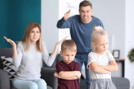 Photo for Parents scolding their children at home. Family conflict - Royalty Free Image