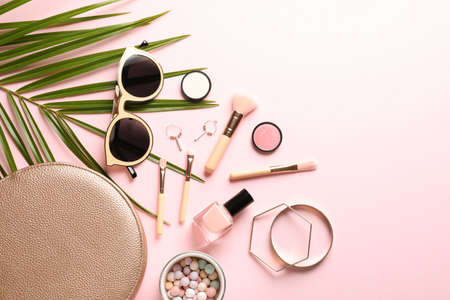 Foto de Flat lay composition with products for decorative makeup on pastel pink background - Imagen libre de derechos