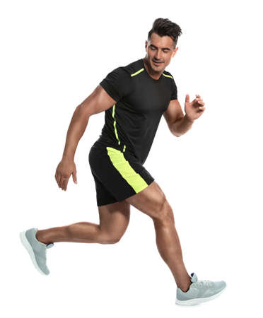 Photo for Sporty young man running on white background - Royalty Free Image