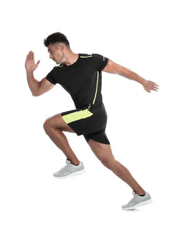 Foto de Sporty young man running on white background - Imagen libre de derechos