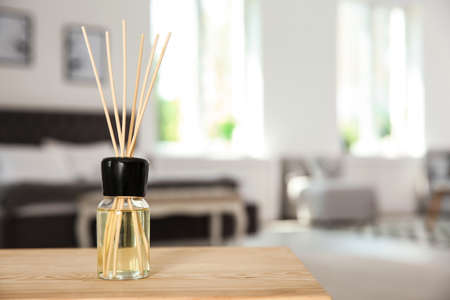 Photo for Aromatic reed air freshener on table indoors - Royalty Free Image