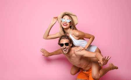 Photo for Happy young couple in beachwear on color background. Space for text - Royalty Free Image