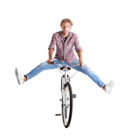 Foto de Handsome young man riding bicycle on white background - Imagen libre de derechos