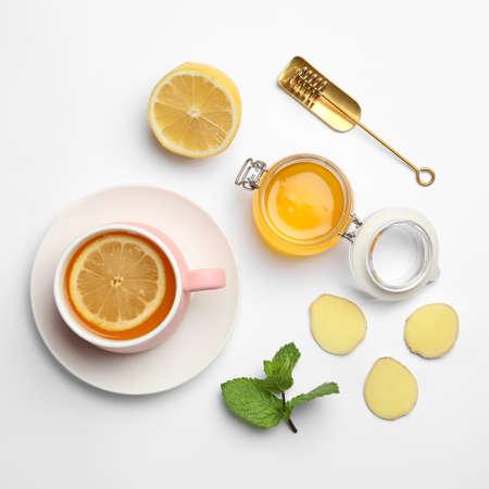 Foto de Composition with lemon tea, honey and ginger on white background, top view - Imagen libre de derechos