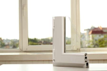 Photo pour Sample of modern window profile on table indoors - image libre de droit