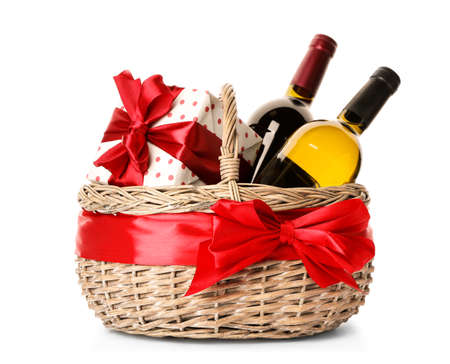 Photo for Festive basket with bottles of wine and gift on white background - Royalty Free Image