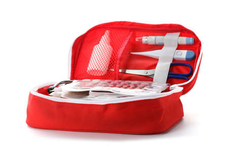 Foto de First aid kit on white background. Health care - Imagen libre de derechos
