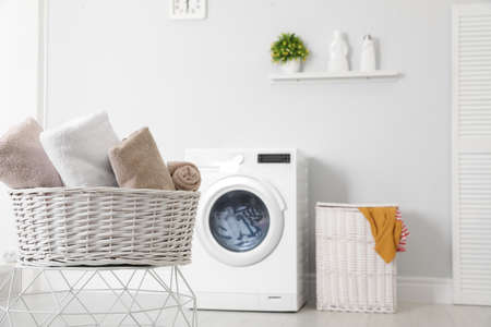 Photo pour Basket with laundry and washing machine on background. Space for text - image libre de droit