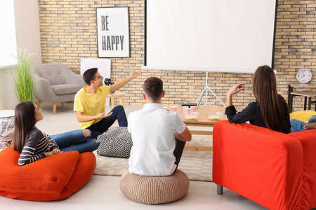 Photo pour Young people watching movie in home cinema - image libre de droit