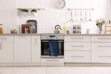 Photo for Light modern kitchen interior with new oven - Royalty Free Image
