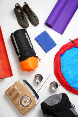 Photo for Flat lay composition with camping equipment on white background - Royalty Free Image