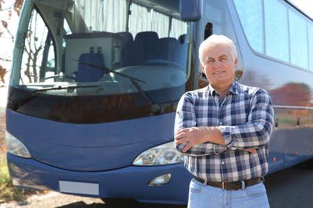 Foto per Professional driver standing near bus. Passenger transportation - Immagine Royalty Free