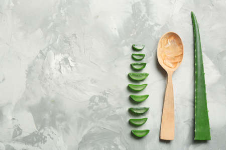 Photo pour Flat lay composition with aloe vera leaves and space for text on gray background - image libre de droit
