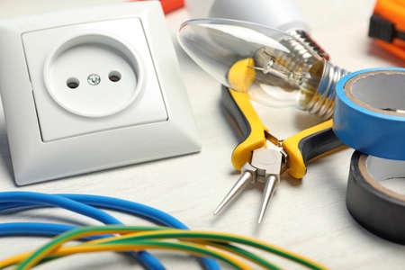Foto de Set of electrician's tools on light table - Imagen libre de derechos