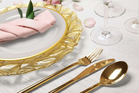 Foto de Festive table setting with plates, cutlery and napkin on wooden background, closeup - Imagen libre de derechos