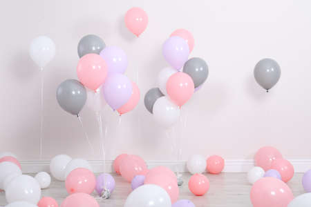 Photo for Room decorated with colorful balloons near wall - Royalty Free Image