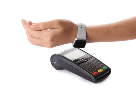 Foto de Woman using terminal for contactless payment with smart watch on white background - Imagen libre de derechos