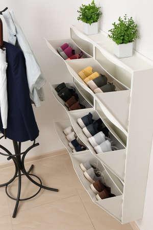 Foto für Shoe cabinet with footwear in room. Storage ideas - Lizenzfreies Bild