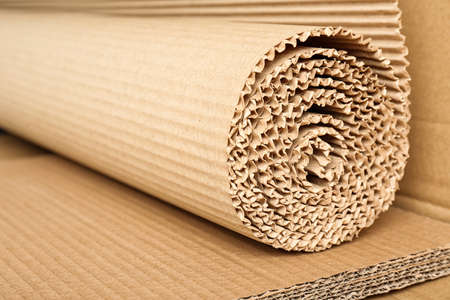 Photo pour Roll of brown corrugated cardboard, closeup. Recyclable material - image libre de droit