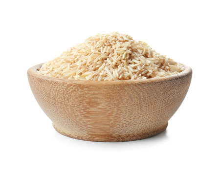 Foto de Bowl with uncooked brown rice on white background - Imagen libre de derechos