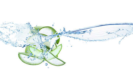 Photo for Slices of juicy aloe with fresh water splashes on white background - Royalty Free Image