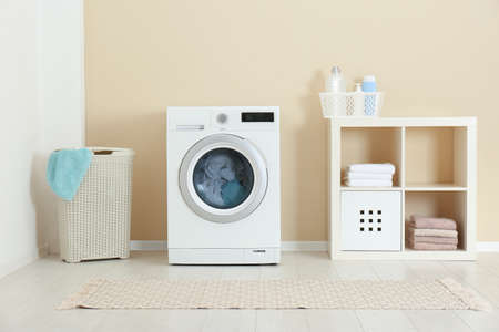 Photo pour Washing of different towels in modern laundry room - image libre de droit