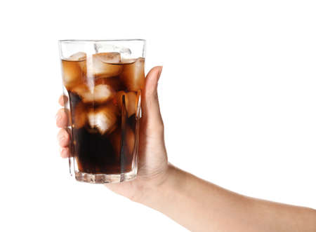 Foto de Woman holding glass of refreshing cola with ice on white background, closeup - Imagen libre de derechos