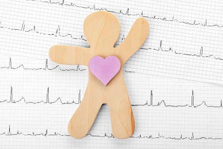 Foto de Human figure with heart on cardiogram, top view - Imagen libre de derechos