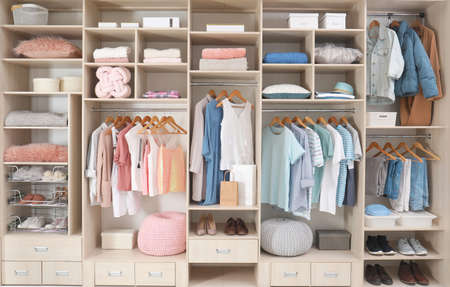 Photo for Stylish clothes, shoes and accessories in large wardrobe closet - Royalty Free Image