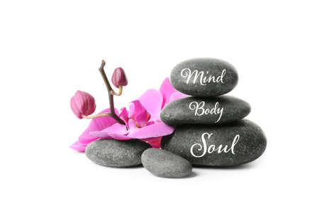Foto de Stack of zen stones with words Mind, Body, Soul on white background - Imagen libre de derechos