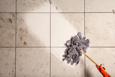 Photo pour Professional cleaner washing dirty floor with mop, top view. Space for text - image libre de droit