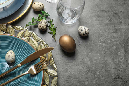 Photo for Festive Easter table setting with eggs on color background, above view. Space for text - Royalty Free Image