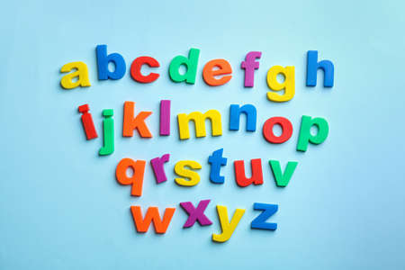Photo pour Plastic magnetic letters on color background, top view. Alphabetical order - image libre de droit