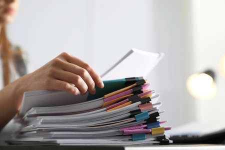 Foto per Office employee working with documents at table, closeup - Immagine Royalty Free
