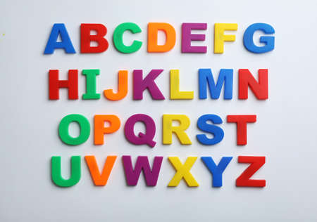 Photo pour Plastic magnetic letters isolated on white, top view. Alphabetical order - image libre de droit