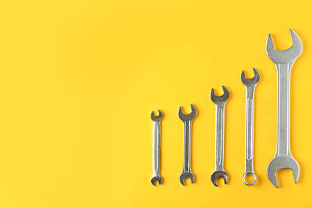 Foto de New wrenches on color background, top view with space for text. Plumber tools - Imagen libre de derechos