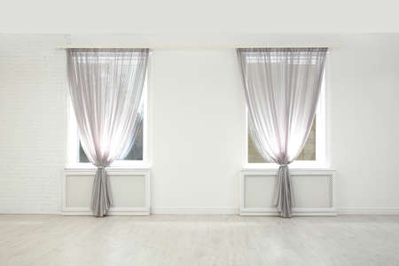 Photo pour Modern windows with curtains in room. Home interior - image libre de droit