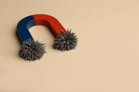Foto de Magnet with iron powder on color background. Space for text - Imagen libre de derechos